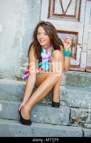 Teen girl legs heels teenage people - Stock Photo