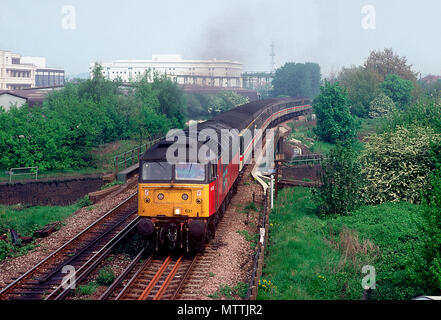 A class 47 diesel locomotive number 47631 heads south onto southern region metals with a 'ruggex' charter near Acton Wells on the 1st May 1993. - Stock Photo
