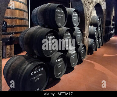 Port wine barrels at the Calem Wine Lodge, Wine Tasting Tour, Vila Nova de Gaia, Porto, Portugal - Stock Photo