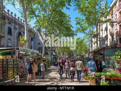 Las Ramblas, Barcelona. Stalls along the busy Rambla Sant Josep, Barcelona, Catalunya, Spain. - Stock Photo
