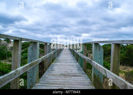 Oak Island North Carolina is home to miles of peaceful beaches and a sturdy lighthouse light station keeping watch over the Atlantic Ocean for ships - Stock Photo