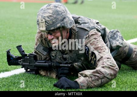 Sgt. 1st Class Terrance Widmer, an Ancona, IL native, assigned to the 2nd Infantry Division/ROK-US Combined Division, performs the high crawl during the physical fitness challenge portion of the Eighth Army 2018 Best Warrior Competition, held at Camp Casey, Republic of Korea, May 17, May 17, 2018. The Eighth Army Best Warrior Competition is being held to recognize and select the most qualified junior enlisted and non-commissioned officer to represent Eighth Army at the U.S. Army Pacific Best Warrior Competition at Schofield Barracks, HI. The competition will also recognize the top performing o - Stock Photo