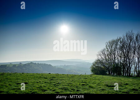 Sunset over the South Downs countryside in Hampshire in England - Stock Photo
