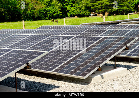 Close up of solar panels with focus on the front. Cades Cove Tennessee - Stock Photo
