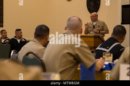 Navy Master Chief Petty Officer Michael J. Fasano speaks during a banquet at the Crow's Nest on Camp Shields, Okinawa, Japan, Jan. 26, 2017. The banquet honored the 2016 Blue Jacket, Junior and Senior Sailors of the Year for each U.S. Naval command on Okinawa. This was the first time all U.S. Naval commands on Okinawa held a collective Sailor of the Year ceremony. Fasano, from Mobile, Alabama, is the command master chief of III Marine Expeditionary Force. (U.S. Marine Corps photo by Cpl. Steven Tran) - Stock Photo