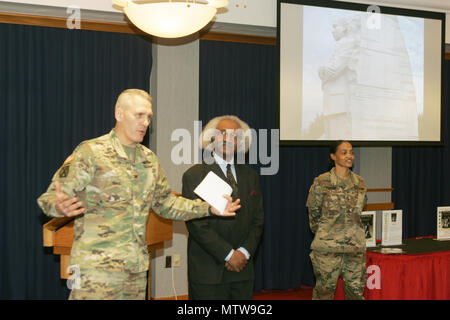 Garrison Commander Col. David J. Pinter Sr. provides closing remarks as Dr. Floyd Rose of Madison, Wis., and Master Sgt. Freida Carter, Fort McCoy equal opportunity adviser, look on during the Fort McCoy observance of Martin Luther King Jr. Day on Jan 12, 2017, at McCoy's Community Center. Rose served as the guest speaker for the event. He is a businessman who's worked for more than 40 years to evaluate, analyze, and develop policy for private- and public-sector organizations concerning sales growth, procurement practices, human-resource management, and policy. He holds leadership positions in - Stock Photo
