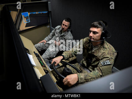 U.S. Air Force Master Sgt. Jon Malone, 1st Combat Camera Squadron combat first sergeant and Staff Sgt. Nicholas Priest, 1st CTCS combat broadcaster, participate in a convoy mission simulation a part of Exercise Scorpion Lens Jan. 26, 2017, at McCrady Training Center, S.C. Exercise Scorpion Lens is an annual Ability To Survive and Operate training exercise mandated by Air Force Combat Camera job qualification standards. Held at the United States Army Training Center Fort Jackson, S. C., and the McCrady Training Center, Eastover, S.C. the exercise's purpose is to provide refresher training to co - Stock Photo