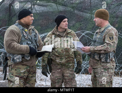 Col. William M. Stubbs, 30th Medical Brigade Commander, Transformation Operations Planner of the G3 Regional Health Command Europe Lt. Col. Marcus A. Hurd and Brigade Pharmacy Officer Maj. Randall J. Sweeney of the Clinical Operations 44th Medical Brigade Fort Bragg NC holding an assessment briefing during the Command Post Exercise on Jan. 17 2017 at the Urban Terrain (UT) site, Wackernheim, Germany.  (From left to right: Lt. Col. Marcus Hurd, Col. William M. Stubbs and Maj. Randall J. Sweeney.)  The 30th Medical Brigade Command Post Exercise scheduled from January 7-17 2017 is one of the grea - Stock Photo