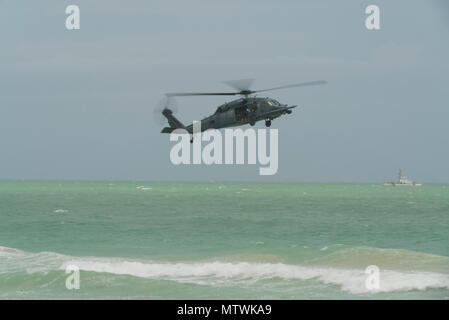 HH-60G Pave Hawks from the 920th Rescue Wing at Patrick Air Force Base in Cocoa Beach, Florida perform a combat search and rescue demonstration at Miami Beach, Florida on May 26th, 2018 during the 2nd annual National Salute to America's Heroes Air and Sea Show. The two-day event showcases military fighter jets and other aircraft and equipment from all branches of the United States military in observance of Memorial Day. (U.S. Air Force Reserve video by Staff Sergeant Nicholas A. Priest) - Stock Photo