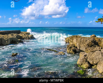 Rocks and strong waves crashing on rocks in the wild north coast of Guadeloupe, Caribbean, French West Indies. - Stock Photo