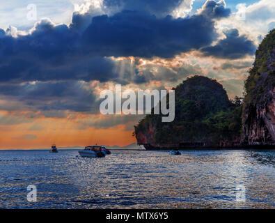 Popular travel tropical karst rocks perfect for climbing Phra Nang Cave Beach in sunset, Krabi province, Thailand - Stock Photo
