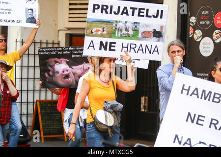 ZAGREB,CROATIA - MAY 19, 2018 : People protesting against animal exploitation in slaughterhouses and holding protest signs in city center in Zagreb, C - Stock Photo