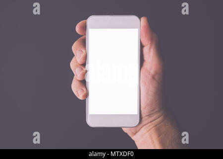 Smartphone in hand, mock up screen copy space, man holding mobile phone device - Stock Photo