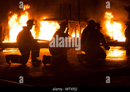 JOHANNESBURG, SOUTH AFRICA - MAY, 2018 Firefighters kneeling during firefighting training exercise Stock Photo