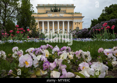 Flowerbed on Ostrovsky Square and the facade of the Alexandrinsky Theater in the city center of St. Petersburg, Russia - Stock Photo