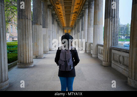 Berlin, Germany - April 4, 2017: Girl/Woman on the middle of the Columns at Alte Nationalsgalerie museum in Berlin - Stock Photo