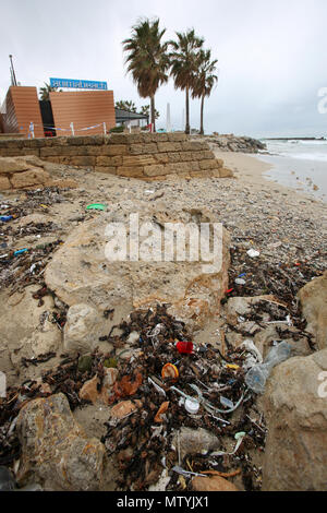 20 March 2018, Spain, Mallorca: Rubbish, mixed with sanitary products, lying on a beach in Palma bay. Sewage works in Palma quickly become overburdened when it rains and raw sewage ends up flowing directly into the sea. The rubbish then lands on the beaches and mixes with the Neptune grass in the sand. Photo: Bodo Marks/dpa - Stock Photo