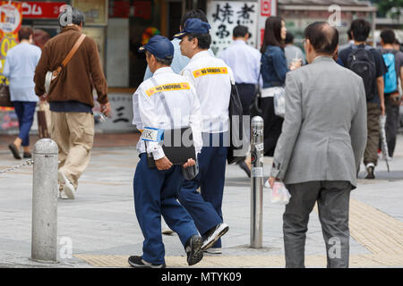 Japanese no smoking area enforcement officers are seen near to Shinjuku Station on May 31, 2018, Tokyo, Japan. The World Health Organization (WHO) and Japan's health ministry continue pushing ''tobacco-free'' plan to ban smoking in all public places ahead of the 2020 Olympic Games, but efforts have so far failed. Credit: Rodrigo Reyes Marin/AFLO/Alamy Live News - Stock Photo