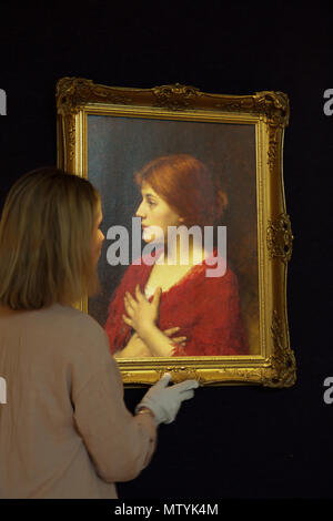 London,UK,31st May 2018,Bonhams held a photocall for the Russian Sale and Rediscovered masterpieces from the Russian Opera in New Bond Street. ALEXEI ALEXEEVICH HARLAMOFF (Russian, 1840-1925) The red shawl. Estimated at £ 40,000 - 60,000 The sale takes place on the 6th June 2018. Credit: Keith Larby/Alamy Live News - Stock Photo