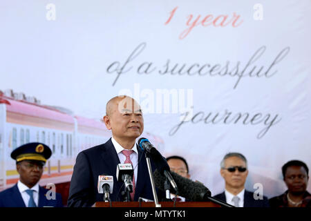 Nairobi, Kenya. 31st May, 2018. Chen Yun (Front), Vice President of China Communications Construction Company (CCCC), delivers a speech at a ceremony marking the first anniversary of the Standard Gauge Railway (SGR) passenger train service in Nairobi, Kenya, on May 31, 2018. Kenya on Thursday marked the first anniversary since the launch of the Standard Gauge Railway passenger train service amid smooth operations that has endeared it to regular travelers, entrepreneurs and tourists. Credit: Wang Teng/Xinhua/Alamy Live News - Stock Photo