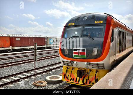 Nairobi, Kenya. 31st May, 2018. A train leaves the Nairobi terminus of Mombasa-Nairobi Standard Gauge Railway (SGR) in Nairobi, capital of Kenya, on May 31, 2018. Kenya on Thursday marked the first anniversary since the launch of the Standard Gauge Railway passenger train service amid smooth operations that has endeared it to regular travelers, entrepreneurs and tourists. Credit: Wang Teng/Xinhua/Alamy Live News - Stock Photo