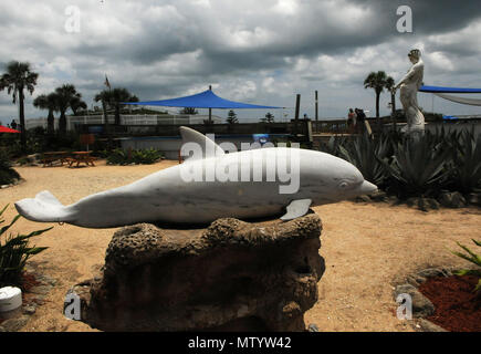 Marineland, USA. May 31, 2018 - Marineland, Florida, United States - A sculpture of a bottlenose dolphin is seen at Marineland Dolphin Adventure in Marineland, Florida during the attraction's 80th anniversary celebration on May 31, 2018. The park, the world's first oceanarium, opened in 1938 as Marine Studios, allowing  filmmakers to shoot underwater footage and visitors to see marine life live and up close. Credit: Paul Hennessy/Alamy Live News - Stock Photo