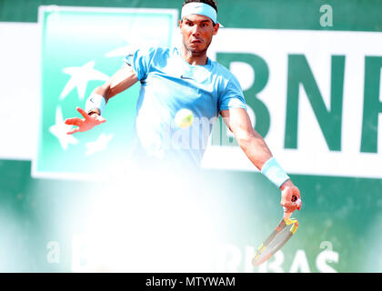 Paris. 31st May, 2018. 1st seeded Rafael Nadal of Spain returns a shot during the men's singles second round match against Guido Pella of Argentina at the French Open Tennis Tournament 2018 in Paris, France on May 31, 2018. Credit: Luo Huanhuan/Xinhua/Alamy Live News - Stock Photo