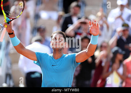 Paris. 31st May, 2018. 1st seeded Rafael Nadal of Spain celebrates after winning the men's singles second round match against Guido Pella of Argentina at the French Open Tennis Tournament 2018 in Paris, France on May 31, 2018. Credit: Luo Huanhuan/Xinhua/Alamy Live News - Stock Photo