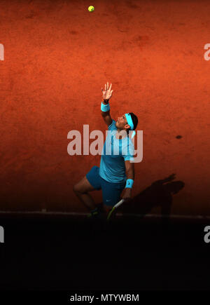Paris. 31st May, 2018. 1st seeded Rafael Nadal of Spain serves during the men's singles second round match against Guido Pella of Argentina at the French Open Tennis Tournament 2018 in Paris, France on May 31, 2018. Credit: Luo Huanhuan/Xinhua/Alamy Live News - Stock Photo