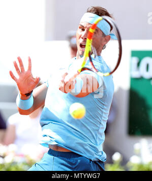 Paris. 31st May, 2018. 1st seeded Rafael Nadal of Spain returans a shot during the men's singles second round match against Guido Pella of Argentina at the French Open Tennis Tournament 2018 in Paris, France on May 31, 2018. Credit: Luo Huanhuan/Xinhua/Alamy Live News - Stock Photo
