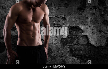 Muscular of a body building trainer man - Stock Photo
