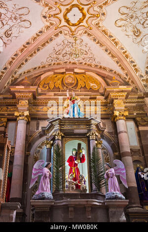 A statue of JESUS CHRIST in the SAN RAFAEL CHURCH is on display for EASTER - SAN MIGUEL DE ALLENDE, MEXICO - Stock Photo