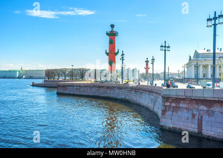 SAINT PETERSBURG, RUSSIA - APRIL 27, 2015: The Spit of Vasiilevsky Island is one of the most notable landmarks with two rostral columns and beautiful  - Stock Photo