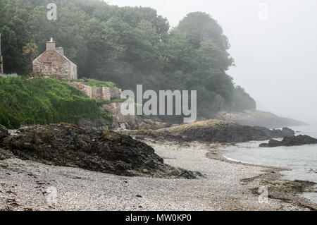 Sea fog rolling in over an empty beach in Jersey, Channel Islands - Stock Photo