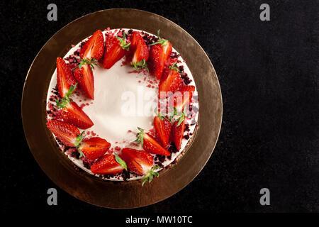 Cheesecake with strawberries. Cake decorated with strawberries. Delicious cheesecake decorated with fresh strawberries. - Stock Photo