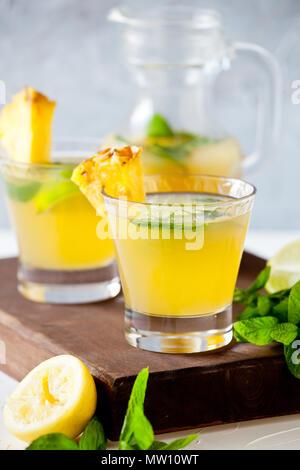 Couple of glasses of refreshing pineapple juice - Stock Photo