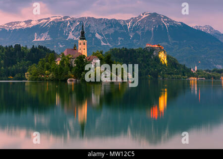 Twilight at Lake Bled with St. Marys Church of the Assumption in Slovenia. - Stock Photo