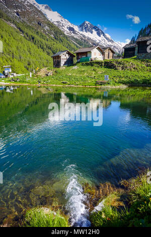 Reflections of mountains and houses, Gouille, Arolla, Evolene, Switzerland, - Stock Photo