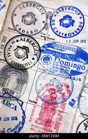 Close up of rubberstamps from a Camino de Santiago / Way of Saint James pilgrim's logbook, Santiago de Compostela, A Coruña, Spain