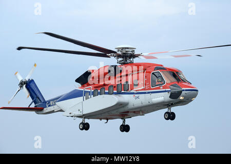 Offshore oil and gas workers travelling to and from work by helicopter to the oil rigs in the north sea at Sumburgh airport in Shetland - Stock Photo