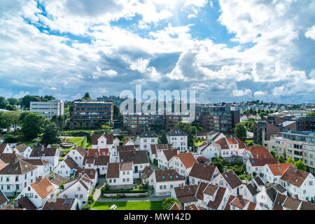 white old village in front of modern buildings - Stock Photo