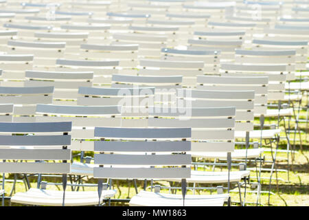 White chair rows in a spa park in medium light - Stock Photo