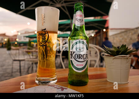 Beer glass and beer bottle on table, Korca beer, Korca, Korça, Albania - Stock Photo
