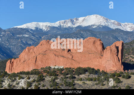 Garden of the Gods, North Gateway Rock, a natural formation, with snowcapped Pikes Peak in background, Colorado Springs, CO, USA - Stock Photo