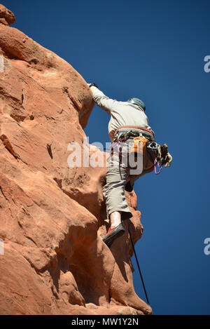Garden of the Gods, rock climber nearing the summit of a rock formation, Colorado Springs, CO, USA