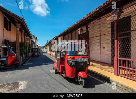 Galle, Sri Lanka - Sep 9, 2015. A tuk tuk taxi at old town in Galle, Sri Lanka. Galle was the main port on the island in the 16th century. - Stock Photo