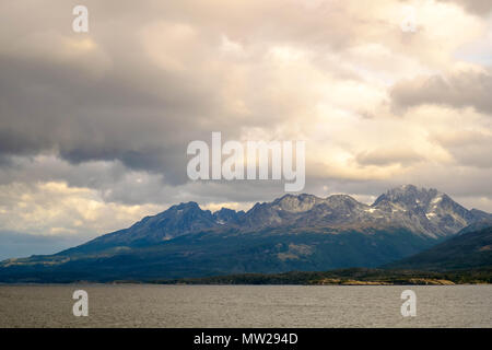 The Beagle Channel and its surrounding mountains as seen froma ferry-cruise from Punta Arenas to Puerto Williams, both in Chile. - Stock Photo