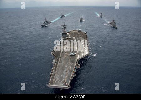 PHILIPPINE SEA (April 28, 2017) Japan Maritime Self-Defense Force destroyers JS Ashigara (DDG 178) and JS Samidare (DD 106), the Arleigh Burke-class guided-missile destroyers USS Wayne E. Meyer (DDG 108) and USS Michael Murphy (DDG 112), Ticonderoga-class guided-missile cruiser USS Lake Champlain (CG 57) and Nimitz-class aircraft carrier USS Carl Vinson (CVN 70) transit the Philippine Sea. The U.S. Navy has patrolled the Indo-Asia Pacific routinely for more than 70 years promoting regional peace and security. - Stock Photo