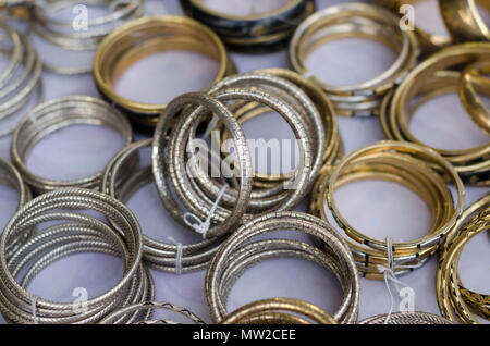 A closeup photo of metallic bangles on display for sale at Shilparamam arts and crafts village, Hyderabad, Telangana, India. - Stock Photo