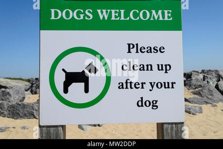 Dogs welcome sign on the beach but please clean up after your dog, UK - Stock Photo